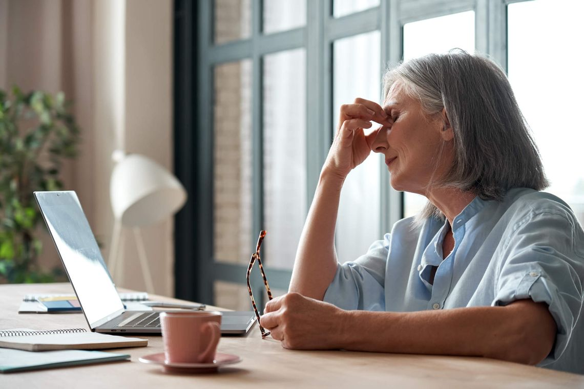 older woman with eye strain